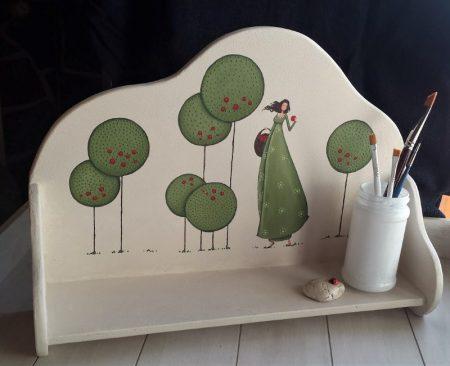 Lesena polička z ilustracijo